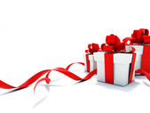 Gifts with red ribbons — Stockfoto
