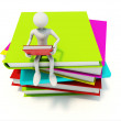 Man with colored books — Stock Photo