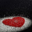 Red heart with snow - Stock Photo