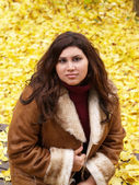 Young Woman in Jacket with Yellow Leaves — Stock Photo