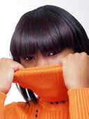 Young black woman pulling sweater — Stock Photo