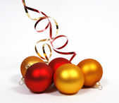 Yellow and red baubles — Stock Photo