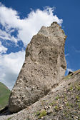 Huge rock against a blue sky with clouds — Stock Photo
