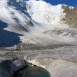 Frozen lake in glacier, Tien Shan rocks — Stock Photo #2133503