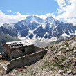Stock Photo: Old disturbed house in Caucasus mountain