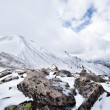 Snow and rocks on the mountain pass — Stock Photo