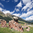 Rocks in mountain grass valley, Caucasus - Stock Photo