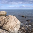 Sea coast with boulders, stones and sky — Stock Photo #2134743