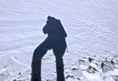 Shadow of climber at the snow surfase — Stock Photo