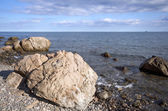 Sea coast with boulders, stones and sky — Stock Photo