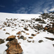 Stock Photo: Rocks, snow, sky and clouds in Caucasus mountains