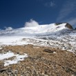 Rocks, snow, sky and clouds in Caucasus mountains — Foto de Stock