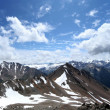 Stock Photo: Rocks, snow, clouds and sky in Caucasus mountains