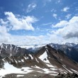 图库照片: Rocks, snow, clouds and sky in Caucasus mountains