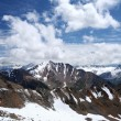 Стоковое фото: Rocks, snow, clouds and sky in Caucasus mountains