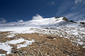 Rocks, snow, sky and clouds in Caucasus mountains — Stock Photo