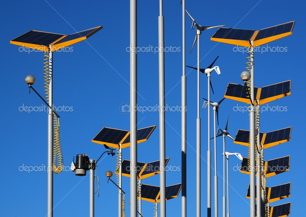 Wind generators and solar power arrays against blue sky — Stock Photo #2466140