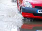 Car driving in water — Stock Photo