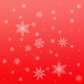 Snowflake pattern on red — Stock Photo