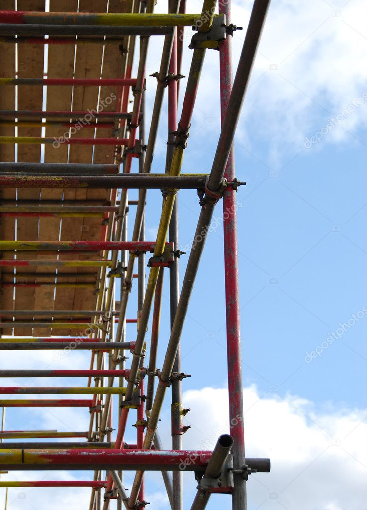 View of scaffolding tower against cloudy blue sky — Stock Photo #2526684