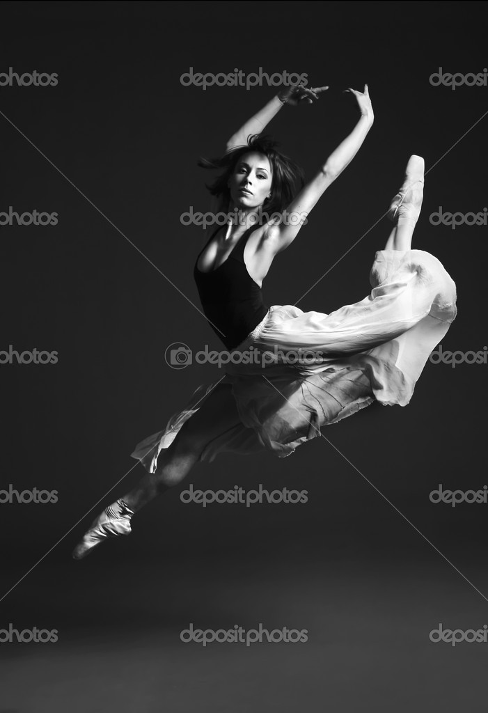 Young female ballet dancer performing on stage.  Foto de Stock   #1997291