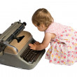 Stock Photo: Baby Girl Typing on a Typewriter
