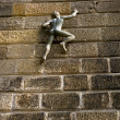 Stock Photo: Climbing Wall Statue