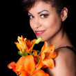 Beautiful Woman Posing with Flowers — Stock Photo