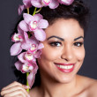 Pretty Woman with Orchid Flower - Lizenzfreies Foto