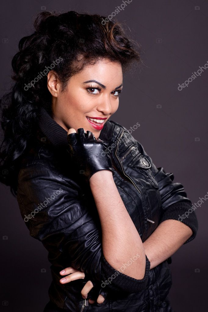 Beautiful sexy woman of mixed ethnicity wearing black leather jacket and fingerless gloves. — Stock Photo #2490368