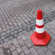 Stock Photo: Traffic cone on cobbled road