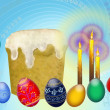 Easter eggs and candles - Stock Photo