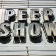 Stock Photo: Peep Show Sign