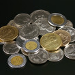 Coins from around the world - Stock Photo