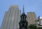 Church and Skyscrapers — Stock Photo
