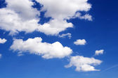 Fantastic soft white clouds against blue sky — Stock Photo