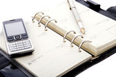 Open notebook with a pen — Stockfoto
