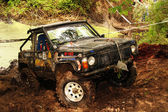 4x4 action through a huge mud hole. — Stock Photo
