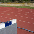 Stock Photo: 3000 metres hurdle on tracks