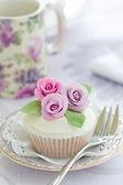 Purple rose cupcake — Stock Photo