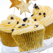 Golden cupcakes — Stock Photo