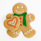 Gingerbread man with gingerbread heart — Stock Photo