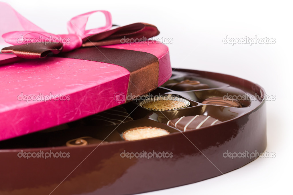 Gourmet chocolates tied with a pink ribbon — Stock Photo #2053825