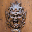 Wooden gargoyle - Stock Photo