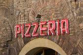 Neon pizzeria sign — Stock Photo