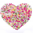 Sprinkles arranged in a heart shape — Stock Photo