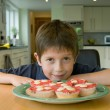 Boy with cupcakes — Stock Photo