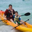 Father and son kayaking - Stockfoto
