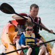 Stock Photo: Father and son kayaking