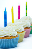 Row of birthday cupcakes — Stock Photo